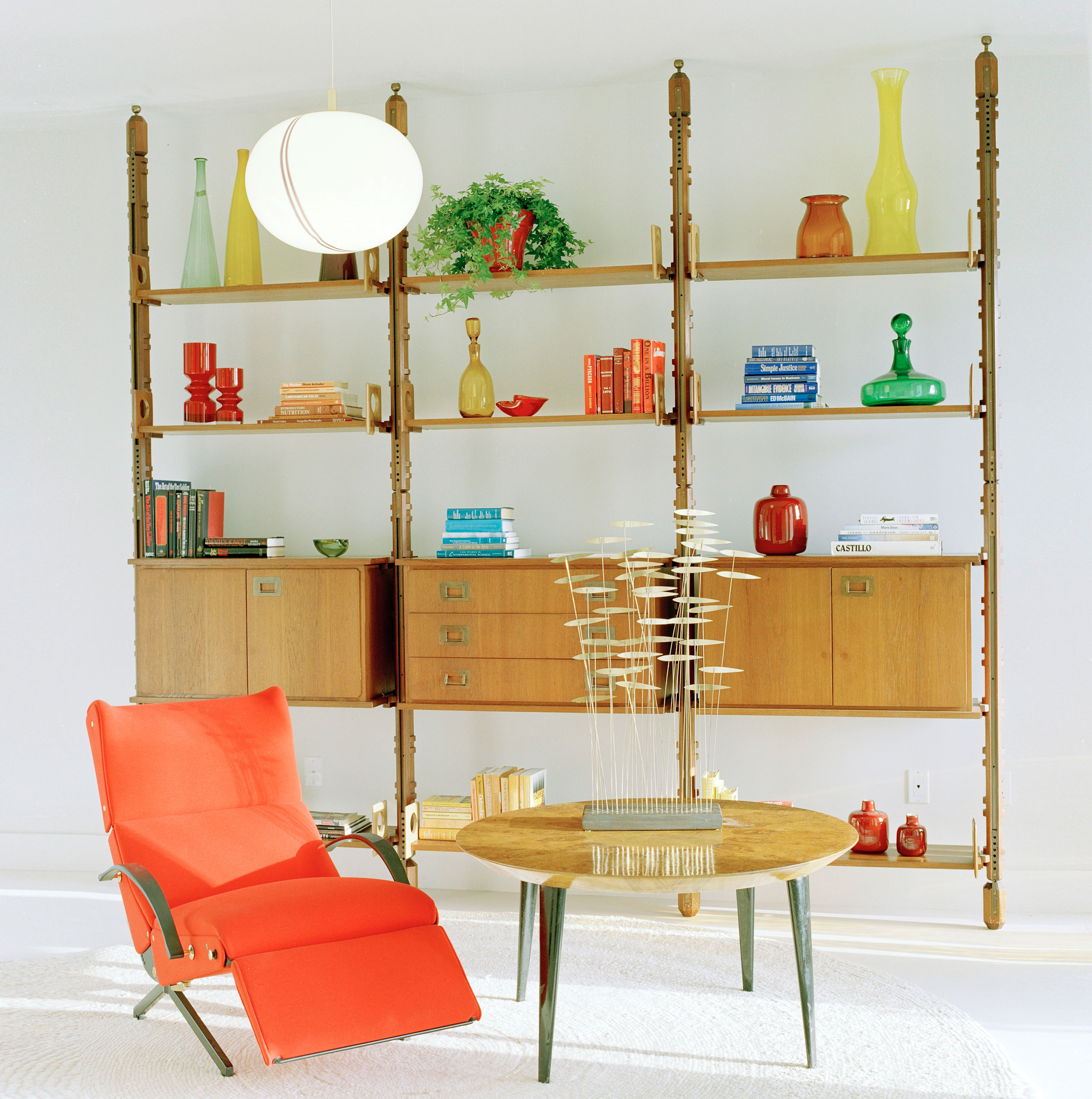 In The Study A Vintage 1950 Tomato Red Leather P40 Chaise By Osvaldo Borsani Sports Rubber Armrests And Brass Details Shelving Unit Is Design