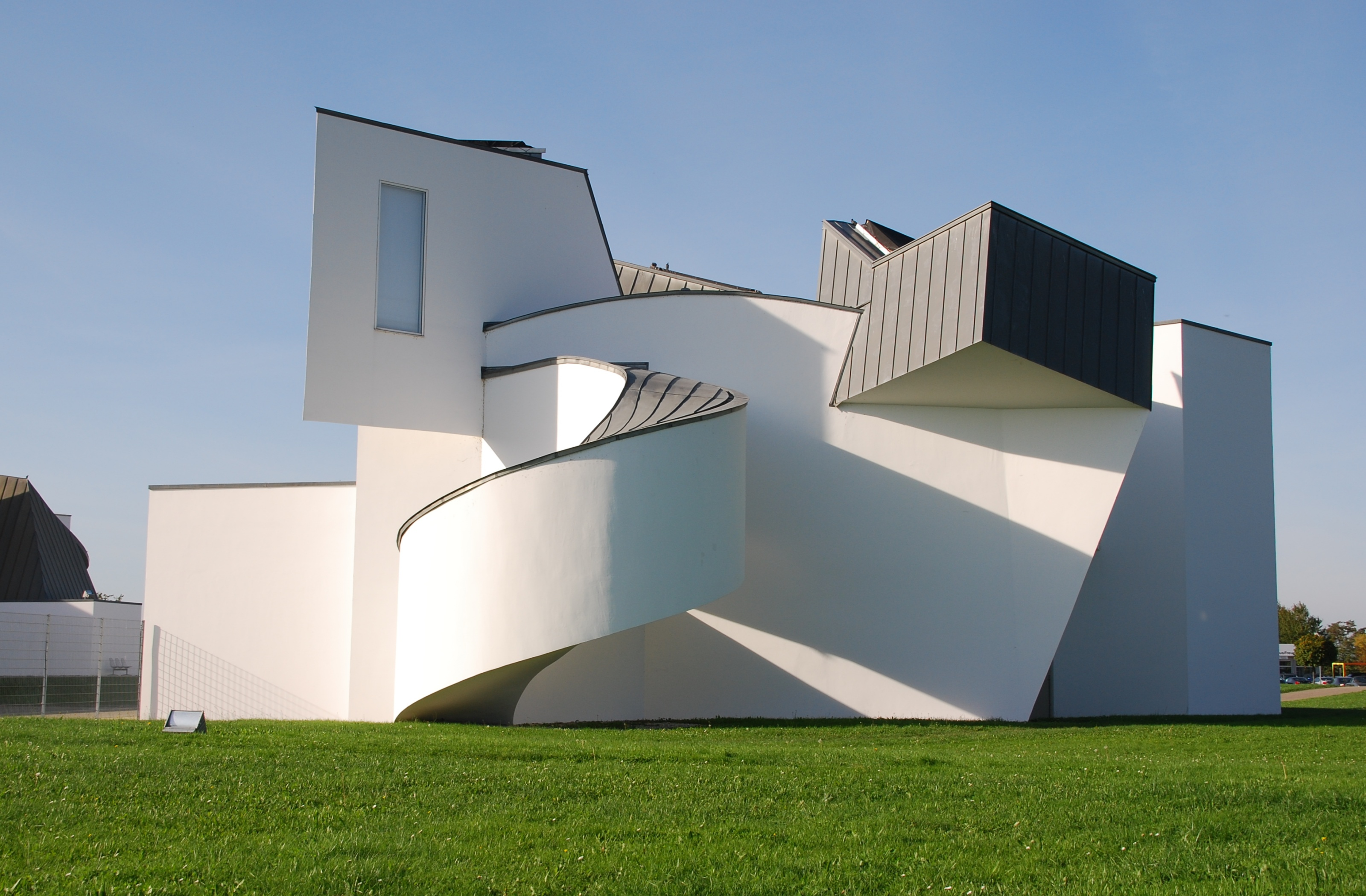Poster vitra design museum - The Exterior Of The Vitra Design Museum Designed By Frank Gehry Is A Whirl Of White Plaster And Titanium Zinc Alloy